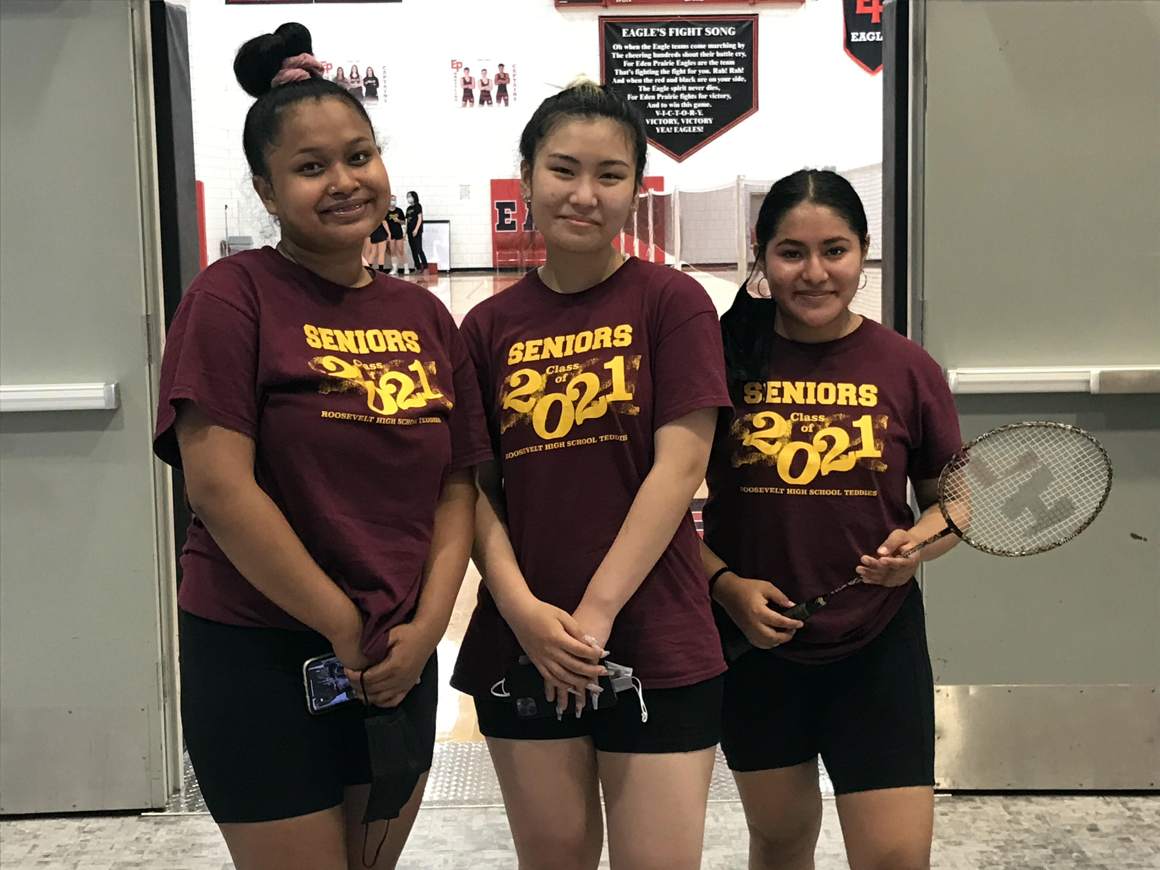 Teddy Badminton players Sabrina Chhoy, Khanh Tran, and Ruth Martinez pose before a match at the State Individual tournament