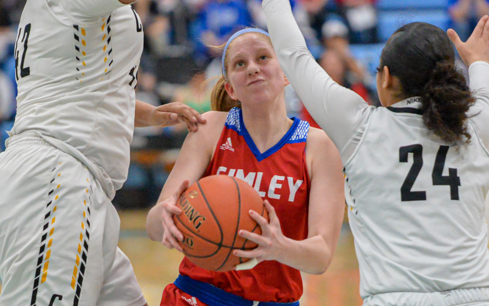 Simley's Sydney Stensgard (center) had 29 points on the night as the Spartans went on to defeat the Cougars 69-53 Thursday night in the Class 3A, Section 3 final. Photo by Earl J. Ebensteiner, SportsEngine