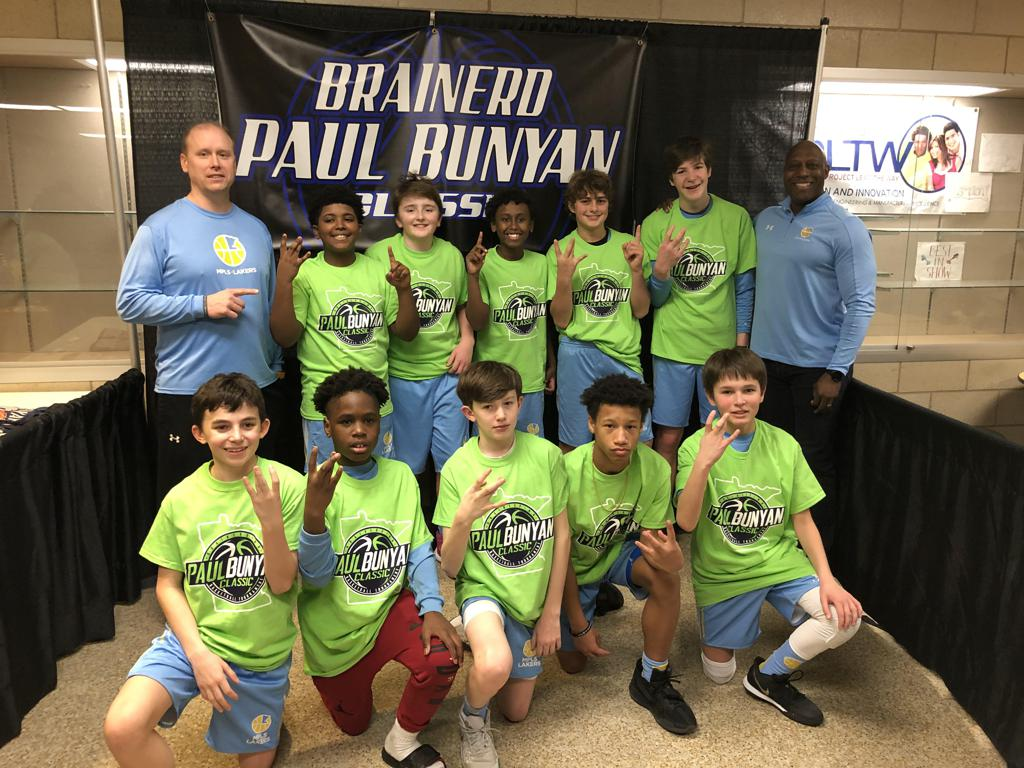 Mpls Lakers Youth Traveling Basketball Program Inc Boys 7th Grade Blue pose with their Trophies after becoming the Champions at the Brainerd Paul Bunyan Classic tournament in Brainerd, MN