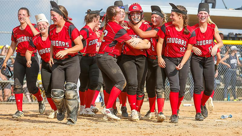 Centennial teammates greet Hailey Thom (with helmet) after her fourth-inning home run tied the game 4-4 and sparked the Cougars to a 15-7 victory over Champlin Park and the Class 4A Section 5 championship. Photo by Mark Hvidsten, SportsEngine