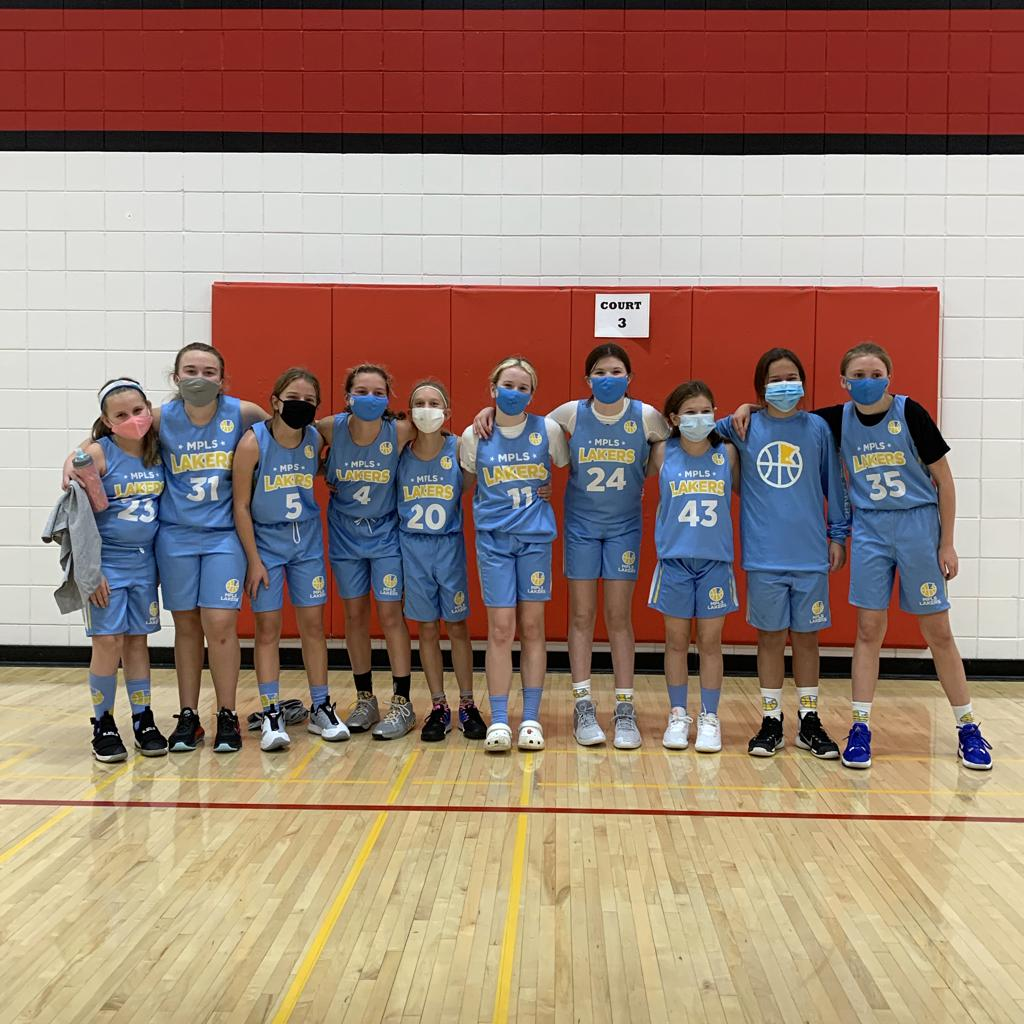 Mpls Lakers Youth Traveling Basketball Program Inc Girls 6th Grade Gold pose after placing 2nd at the Lakeville Panther Classic 6B Bracket tournament in Lakeville, MN