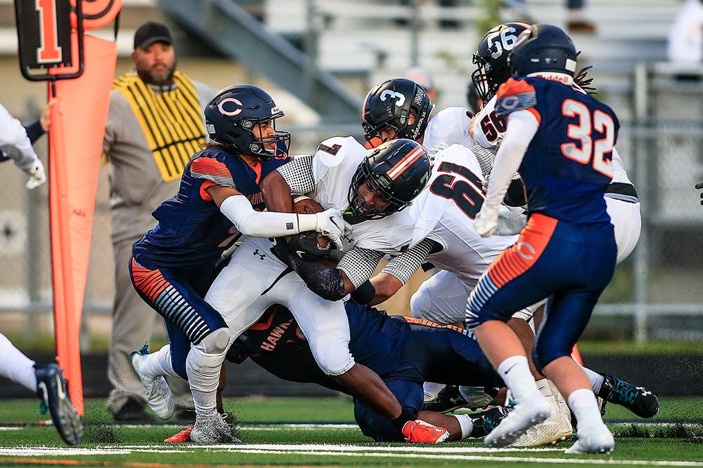 St. Louis Park running back Sajid Nathim (7) is tackled by Robbinsdale Cooper defender Taurean Cain in the second quarter. Photo by Mark Hvidsten, SportsEngine