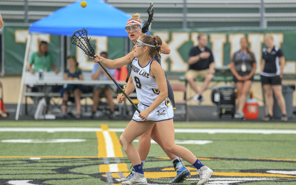 Prior Lake's Josie Kropp battles for control of a draw against Apple Valley Thursday night. The Lakers fell to the Eagles 13-12 in the Section 6 final in Edina. Photo by Jeff Lawler, SportsEngine