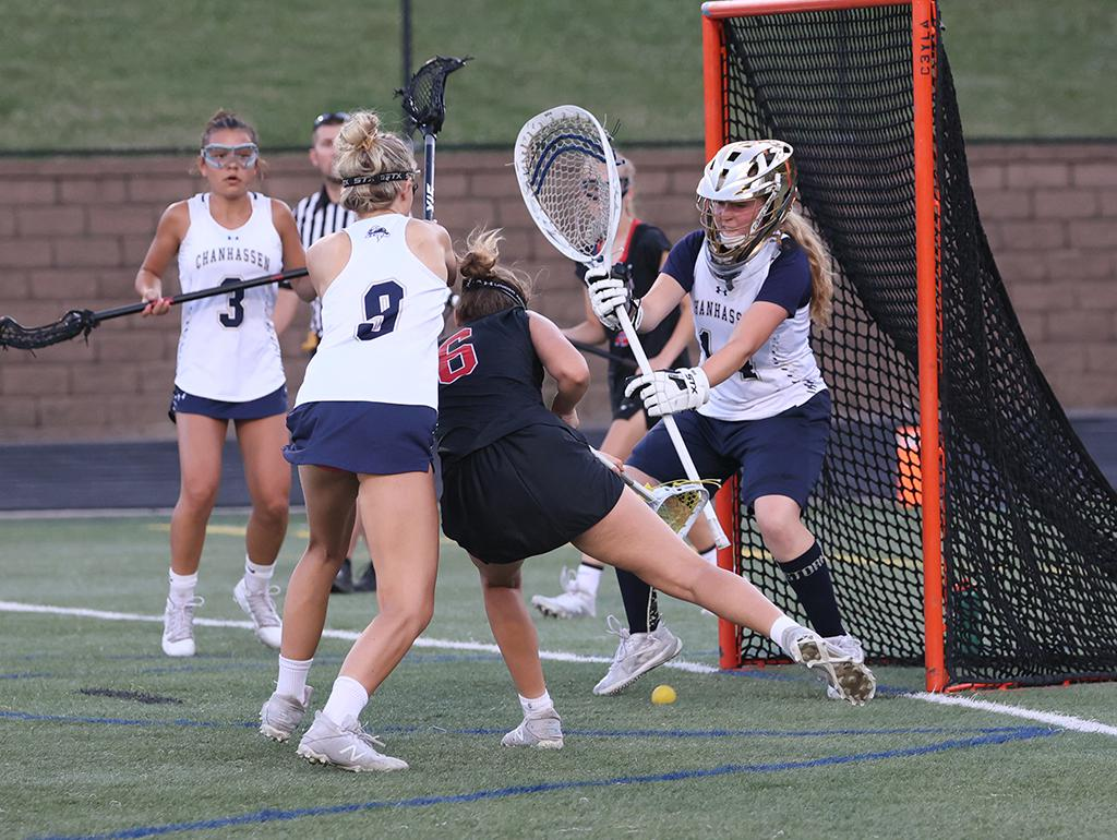 Josie Lillquist (6) scores a goal in the first half. Lillquist's 4 goals and 2 assists led Eden Prairie to a 14-13 win, and a trip to next week's state tournament in Stillwater. Photo by Cheryl A. Myers, SportsEngine