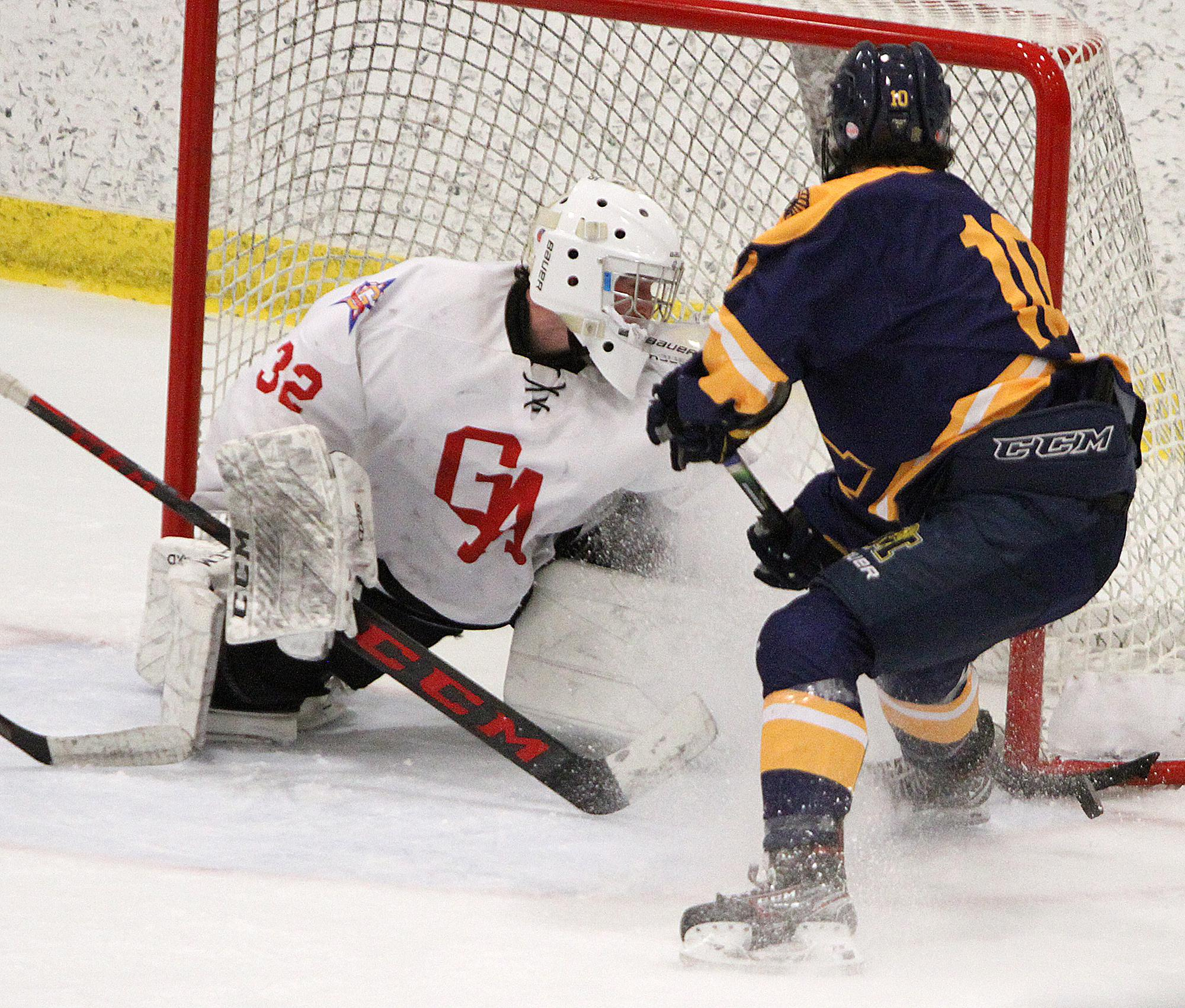 Mahtomedi senior forward Adam Johnson is stopped on a prime scoring chance by Gentry Academy senior goalie Alex Timmons in the third period. Johnson finished with one goal, and Timmons made 28 saves Thursday. Photo by Drew Herron, SportsEngine