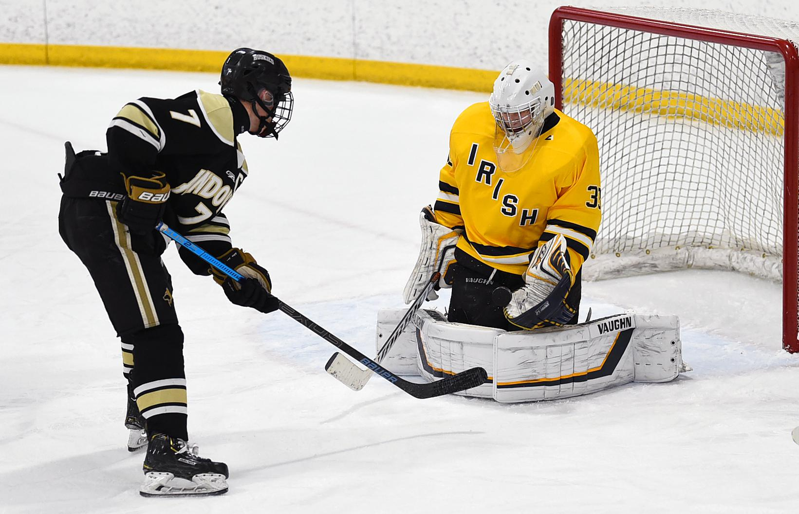 A close-range shot by Andover's Luke Kron is stopped by Rosemount goaltender Will Tollefson during Thursday's game at the St. Louis Park Rec Center. Photo by Loren Nelson, LegacyHockeyPhotography.com