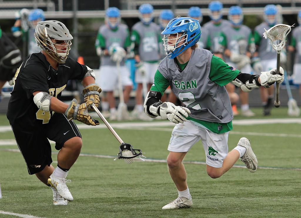Isaac Peifer (2) takes advantage of an open lane to put the Wildcats back on top early in the fourth quarter. Peifer led the field with five goals and an assist as Eagan narrowly defeats East Ridge 11-10. Photo by Cheryl Myers, SportsEngine