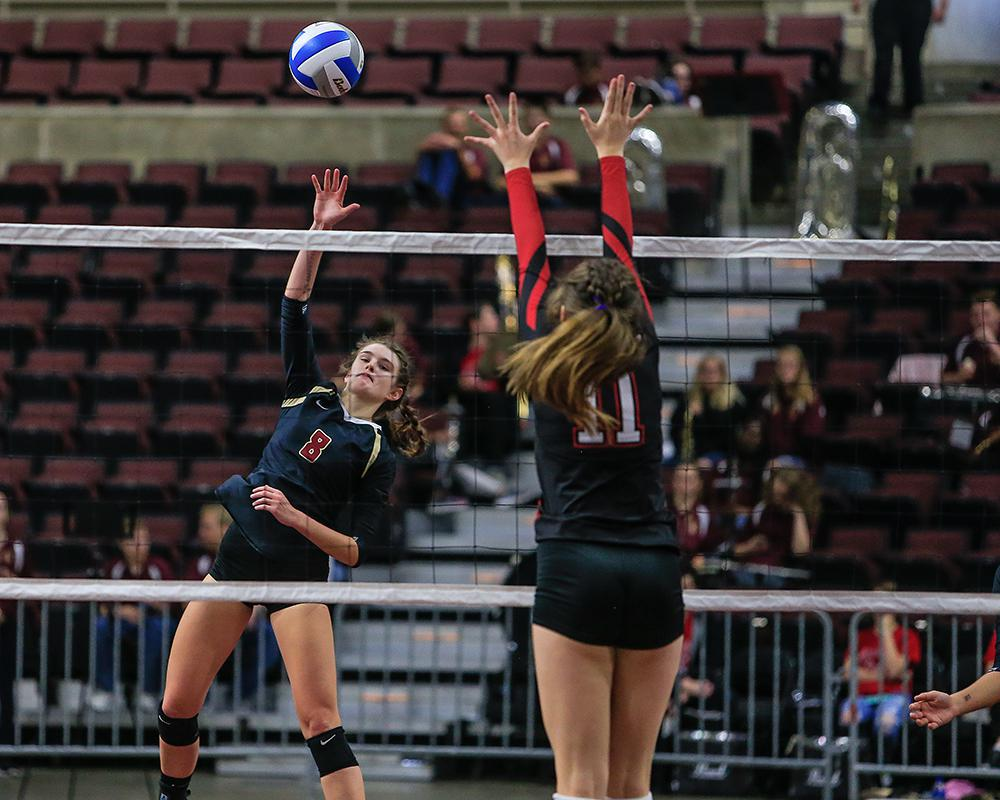 Lakeville South's Jasmine Mulvihill (8) led the Cougars with 25 kills and 22 digs. Photo by Mark Hvidsten, SportsEngine