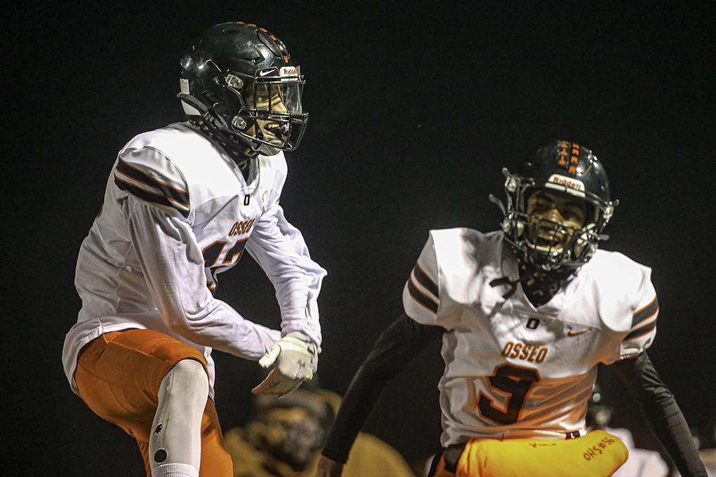Osseo receiver Micheal Henderson, left, celebrates his reception that set up a second-half touchdown with teammate KK Toten. Photo by Mark Hvidsten, SportsEngine