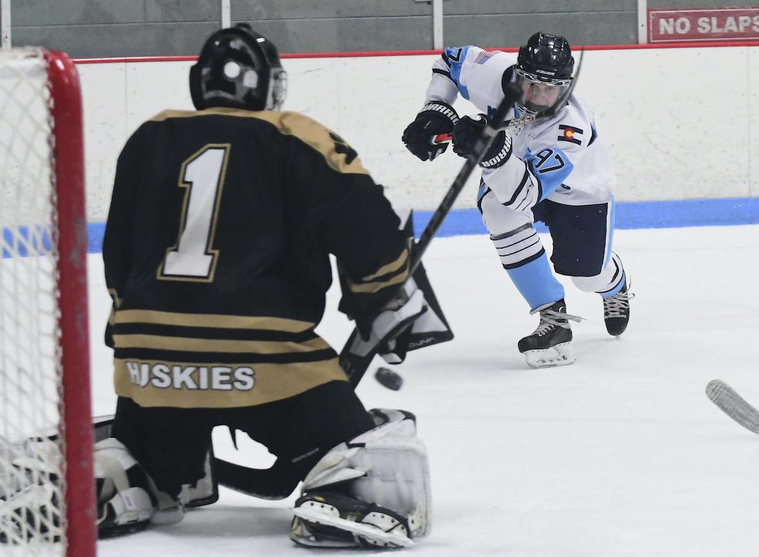 Chase Coisman (97) scored twice to help Ralston Valley roll Vail 7-0 in a CPHL Tier 1 tilt Saturday at the Apex Center. The junior is second in the league in points (25) and third in goals (15) this season. Photo by Steven Robinson, SportsEngine