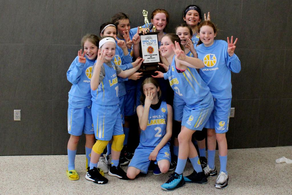 Minneapolis Lakers Girls 5th Grade Gold pose with their Medals & team trophy after taking 3rd place at the MYAS Grade State year end tournament