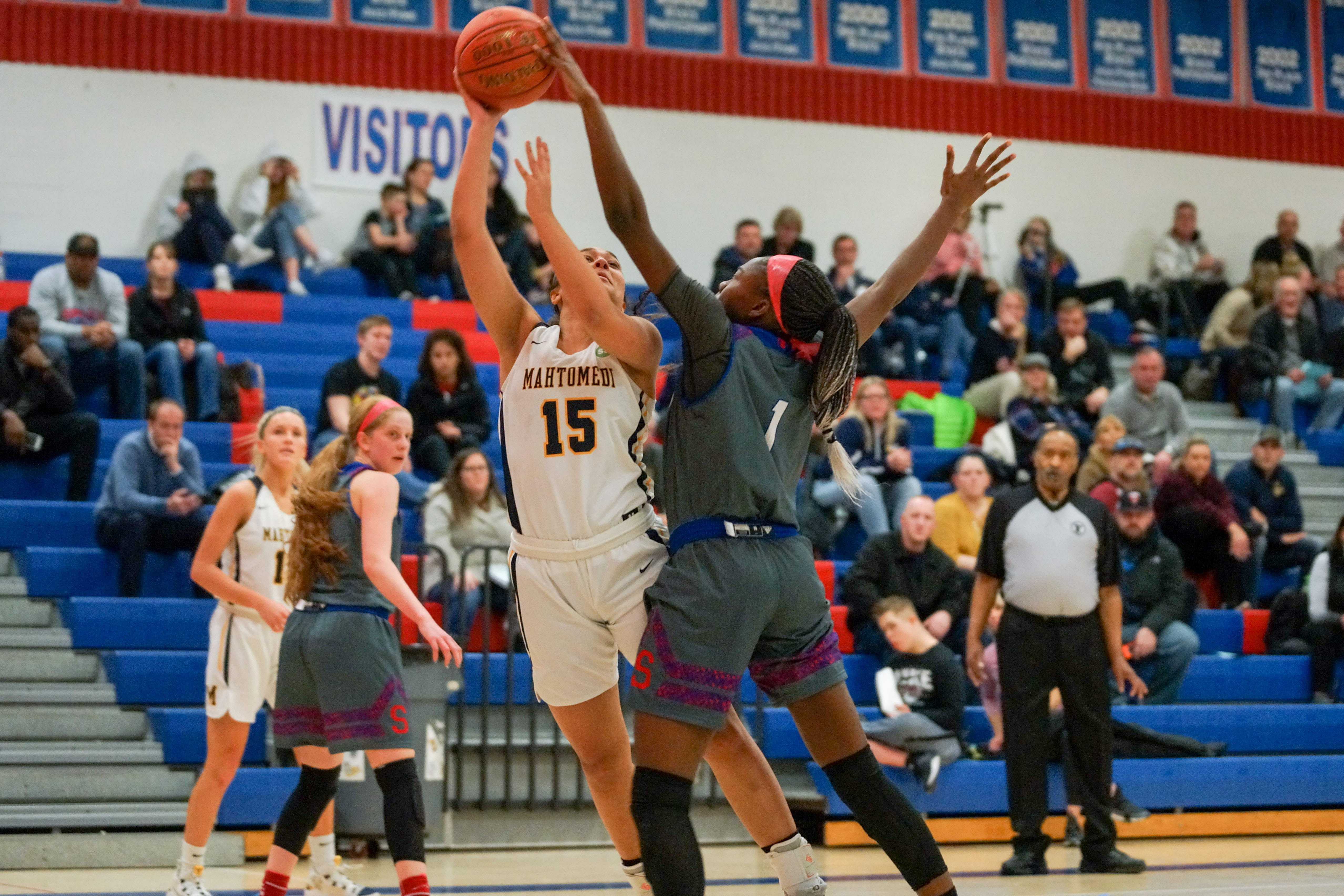 Simley's Acheampomaa Danso (1) with a block against Mahtomedi's Zoey Washington Tuesday night. Photo by Korey McDermott, SportsEngine