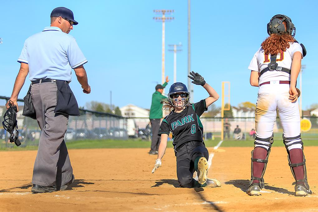 Park of Cottage Grove baserunner Hannah Schluetter slides in with what became the winning run in the Wolfpack's 2-1 victory at Forest Lake. Corinna Loshek's infield single brought Schluetter home in the fifth inning. Photo by Mark Hvidsten, SportsEngine