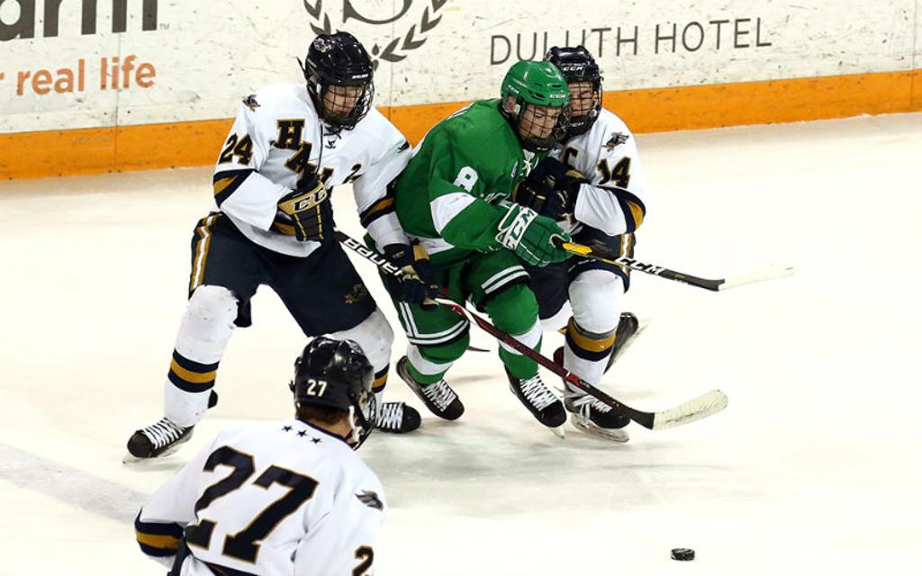 Greenway's Ben Troumbly (in green) fights through a pack of Hermantown defenders in the Class 1A, Section 7 final on Feb. 27. Troumbly was one of four Raiders to make the Class 1A all-tourney team. Photo by Dave Harwig, SportsEngine