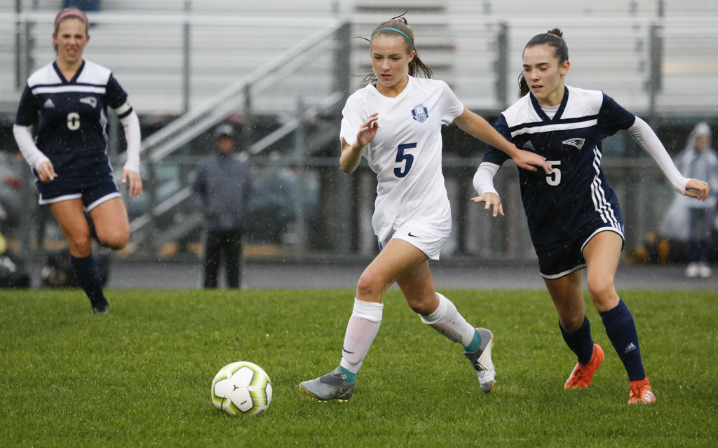 Blaine's Samantha Proulx (5) tries to get separation from Champlin Park's Paige Kalal (5) during the first half of Tuesday evening's match. The Bengals fell to the Rebels 3-0. Photo by Jeff Lawler, SportsEngine