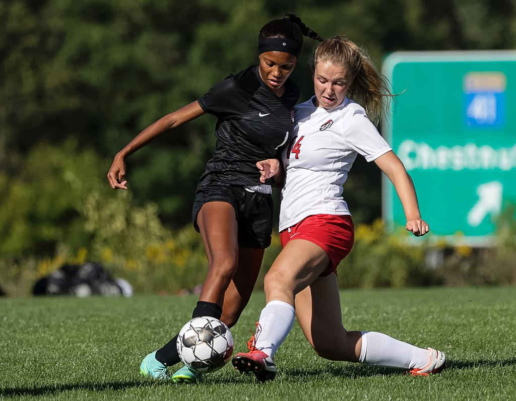 Maya Johnson (1) and Kylee Tiarks (14) battle for possession in the first half. Johnson scored the game winning goal for the Stars in a 3-1 win over St. Croix Lutheran Academy. Photo by Cheryl A. Myers, SportsEngine