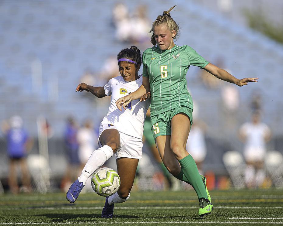 Edina's Maddie Dahlien (5) battled her way past Wayzata defender Ramira Ambrose (4) to get a shot on goal in the first half. Dahlien scored twice in the Hornets' 3-0 victory. Photo by Mark Hvidsten, SportsEngine