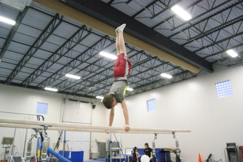 all boys event parallel bar practice
