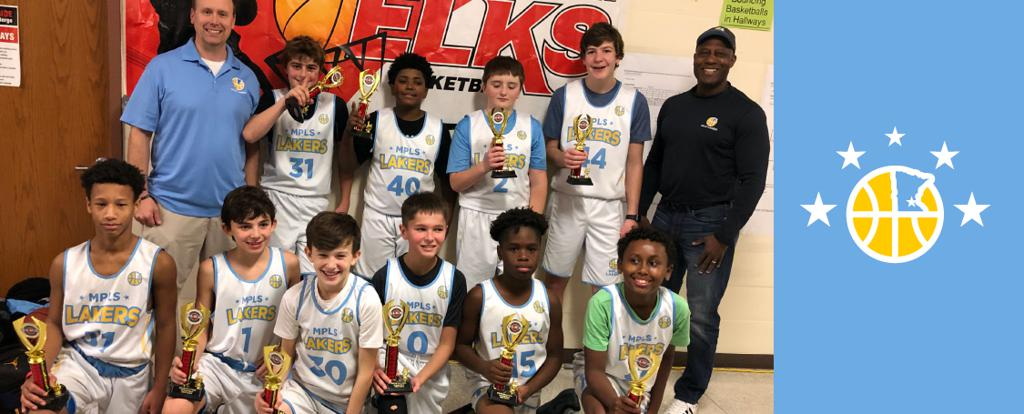 Minneapolis Lakers Boys 7th Grade Blue pose with their Trophies after becoming the Champions at the Elk River Elks Classic tournament in Elk River, MN