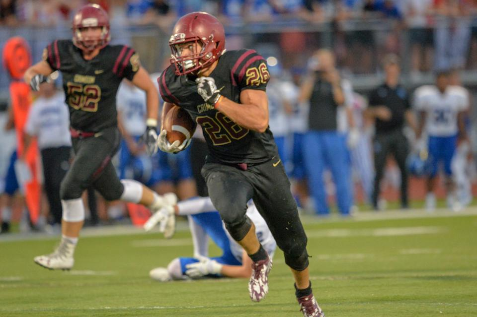 Maple Grove senior Evan Hull finds a hole up the middle Friday night in the second quarter against Minnetonka and carries the ball into the end zone for the touch down. The Crimson beat the Skippers 35-16 Photo by Earl J. Ebensteiner, SportsEngine