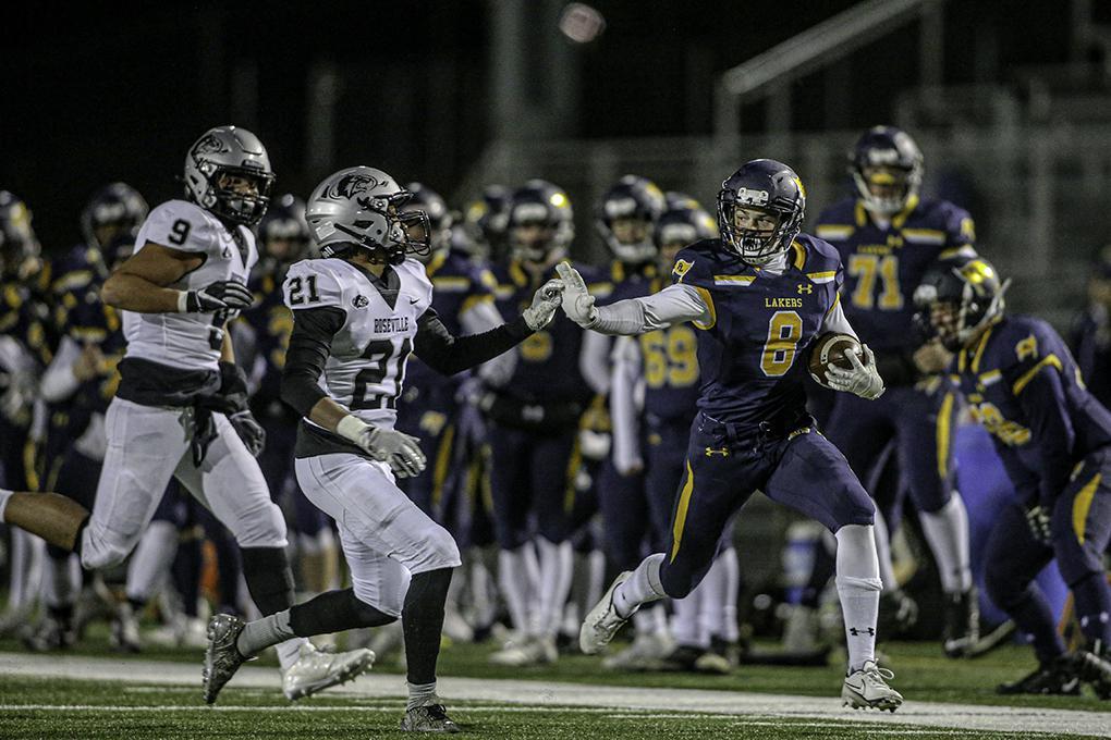 Prior Lake's Tyler Shaver (8) held off Roseville defender Treygan Adams (21) on his way to a long second-quarter touchdown. Photo by Mark Hvidsten, SportsEngine