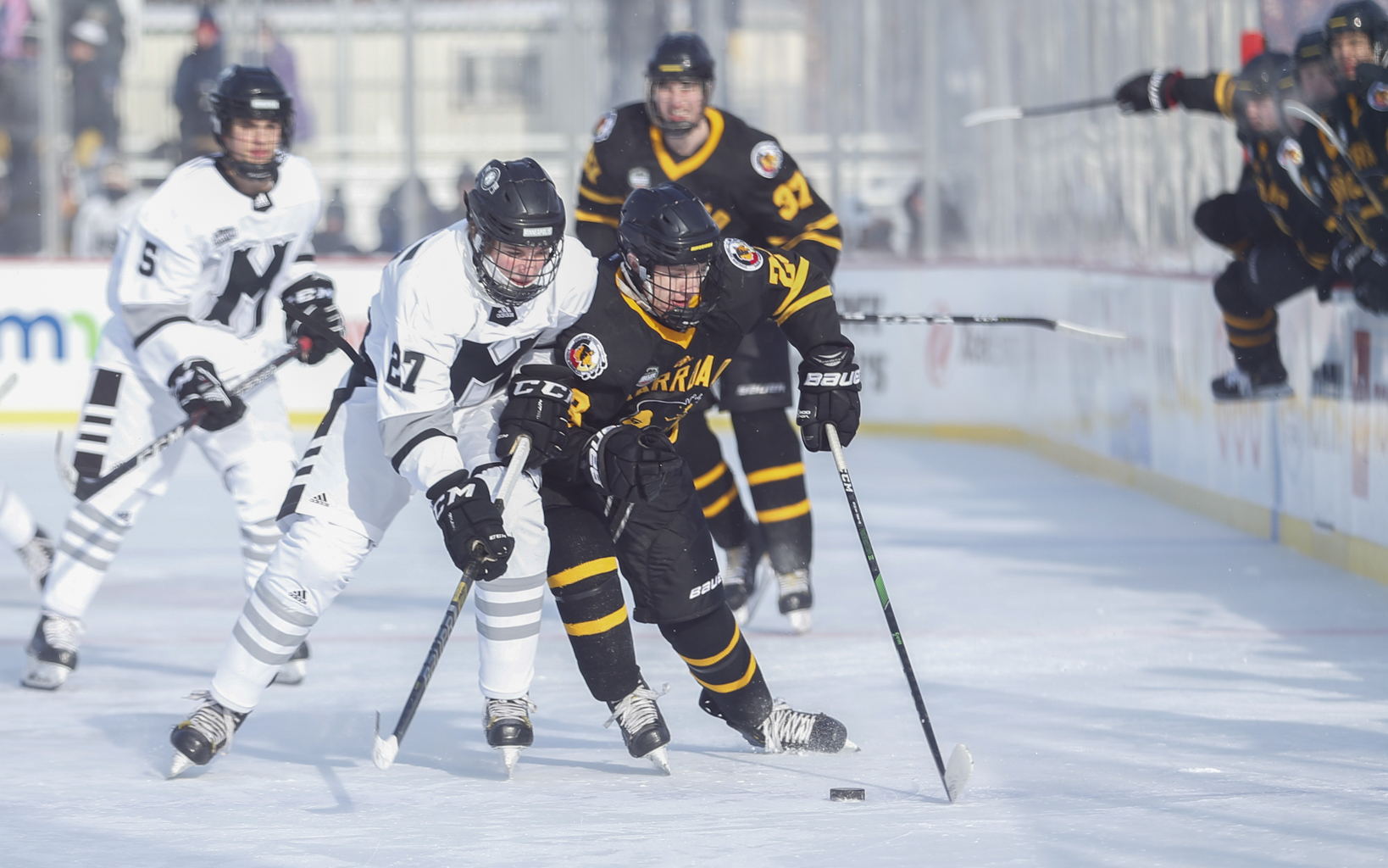 Warroad's Owen Meeker (23) tangles with Minneapolis' Evan Grimm (27) as he enters the offensive zone Saturday morning. Meeker had two goals and an assist in the Warriors' 5-1 victory over Minneapolis at Parade Stadium. Photo by Jeff Lawler, SportsEngine