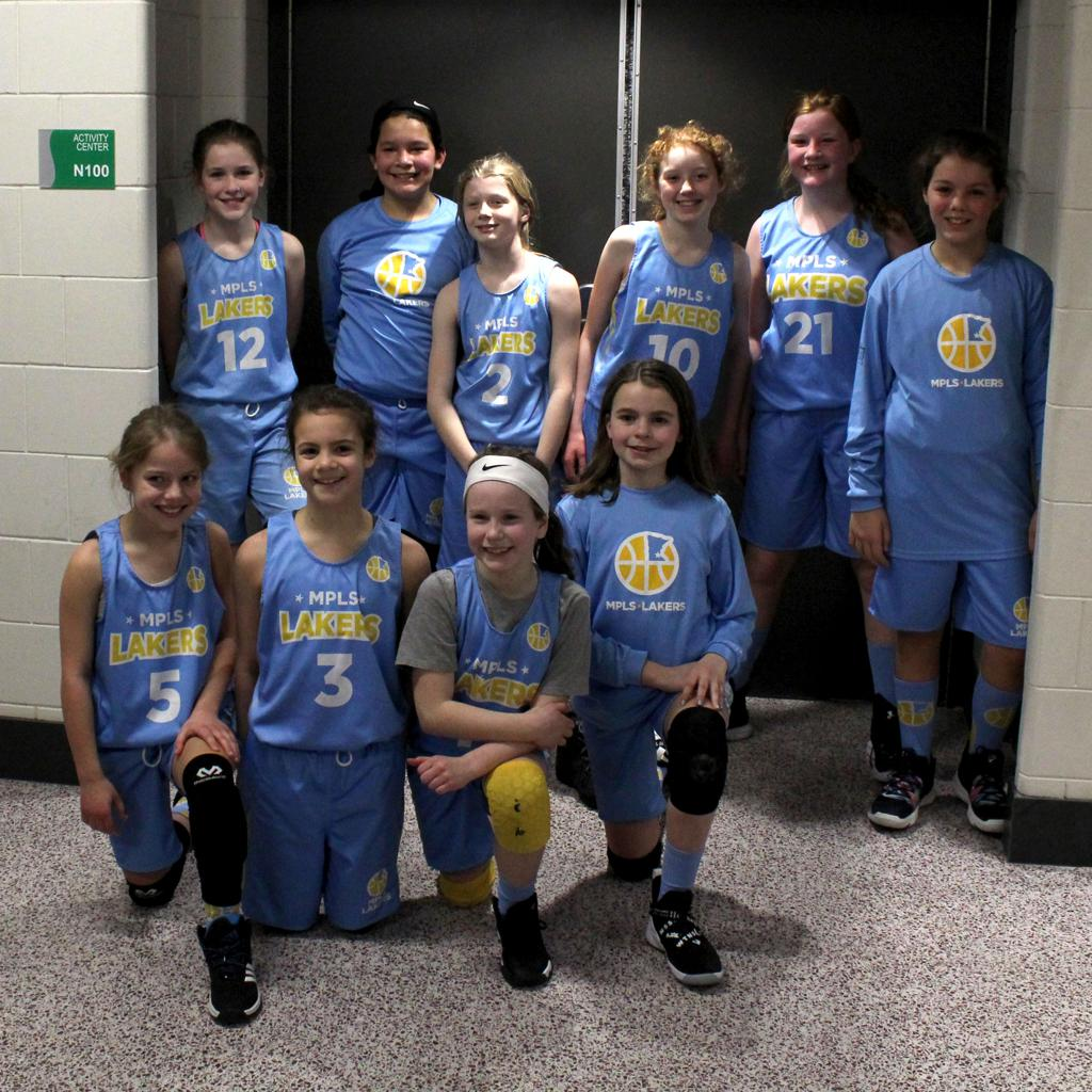 Minneapolis Lakers Girls 5th Grade Gold pose after taking 3rd Place at the JEdina Girls Classic Basketball tournament in Edina, MN