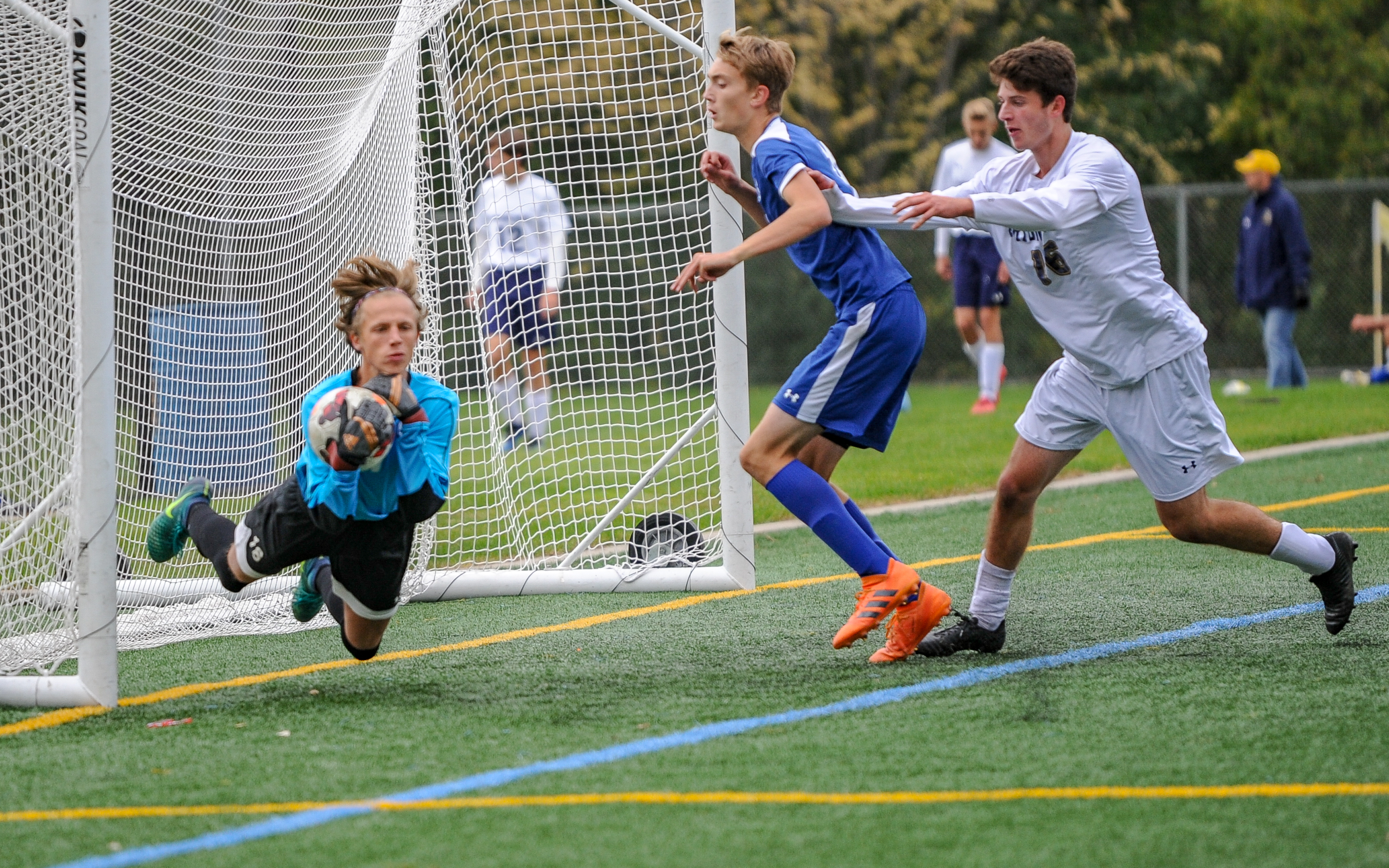Minnetonka's goalkeeper Luca Vereecken makes a diving save in the second half of Saturday's game against Prior Lake. The Skippers went on to beat the Lakers 1-0. Photo by Earl J. Ebensteiner, SportsEngine