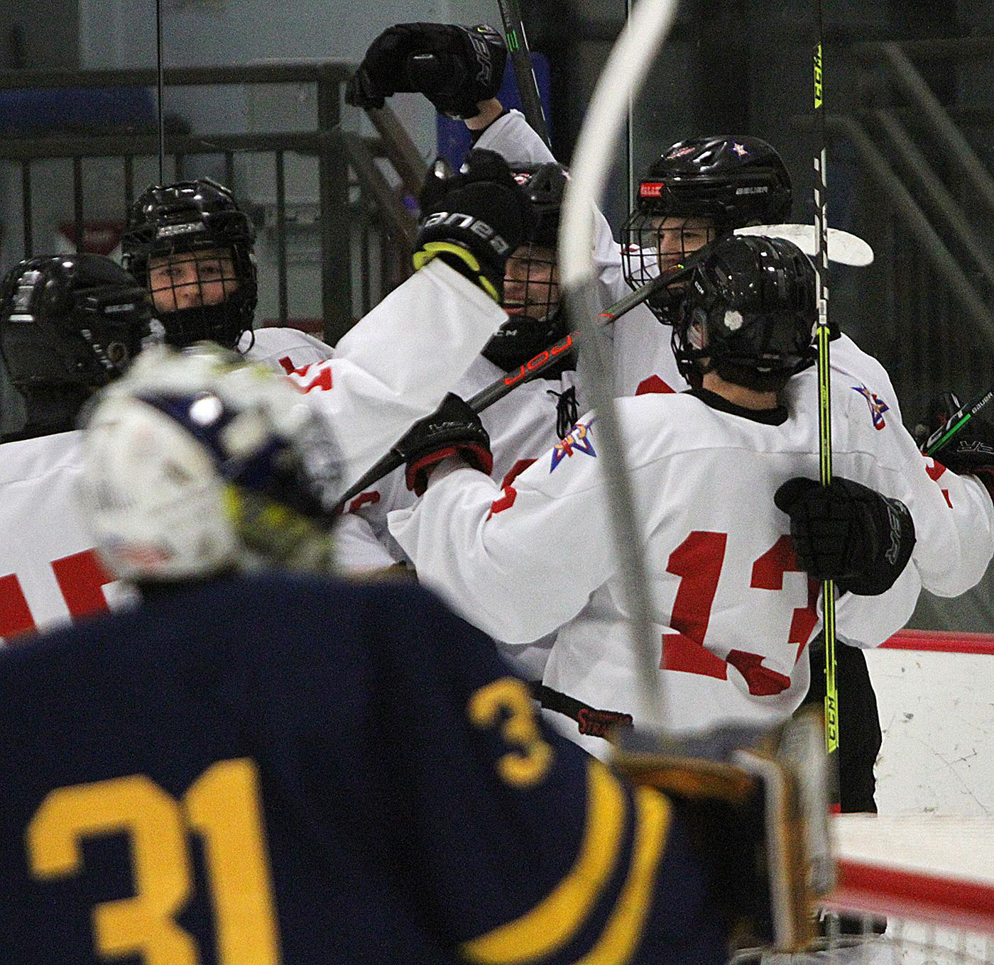 Gentry Academy celebrates a goal by Zach Reim during a three-goal burst over 1 minute, 6 seconds late in the first period. Reim and Bailey McGraw (13) each scored twice in the Stars' 8-2 defeat of Breck. Photo by Drew Herron, SportsEngine