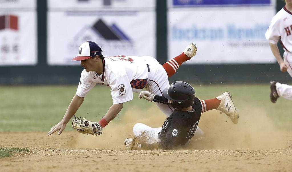 Second baseman Gavin Thennis falls to the ground while a Bozeman Bucks player slides into second base during a game against the Helena Senators earlier this season. Gary Marshall, BMGphotos.com