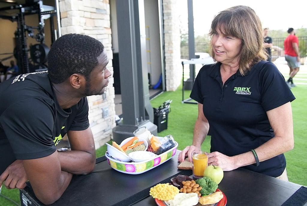 Lisa Money, dietitian with Apex Athletic Performance, speaks with client about nutrition