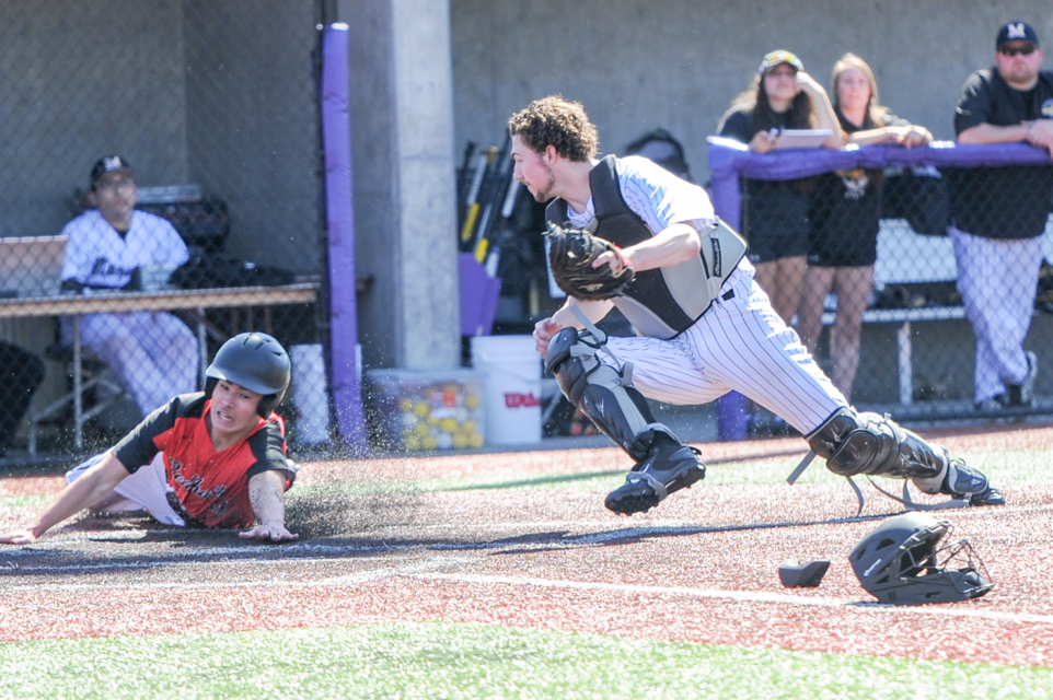 Minnehaha Academy's Jake McCabe slides into home plate in the bottom of the seventh inning scoring the winning run against Duluth Marshall on Saturday afternoon defeating the Hilltoppers 5-4 at the University of Northwestern. Photo by Earl J. Ebensteiner,