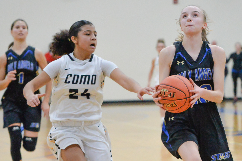 Holy Angels' Isabelle Henry is on her way to scoring the game-winning basket at home Tuesday night, which gave St. Paul Como Park its first loss of the season. The Stars won 90-88 in overtime. Photo by Earl J. Ebensteiner, SportsEngine