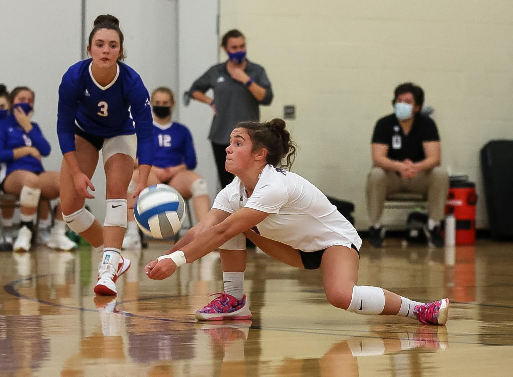 Sophomore libero Kate Thibault (4) gets low for a dig in the second set.  Thibault finished with 22 digs helping the Royals rally to a four-set win at Watertown-Mayer High School. Photo by Cheryl A. Myers, SportsEngine