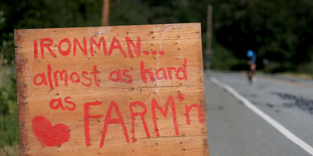 "Sign near road reads""IRONMAN... almost as hard as FARM'n"""