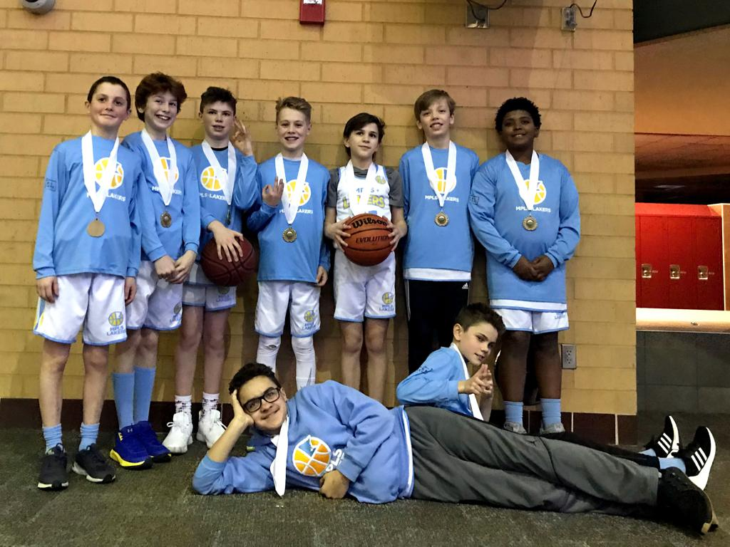 Minneapolis Lakers Boys 6th Grade Gold  pose with their hardware after taking 3rd Place at Lakeville South Cougar Classic in Lakeville, MN