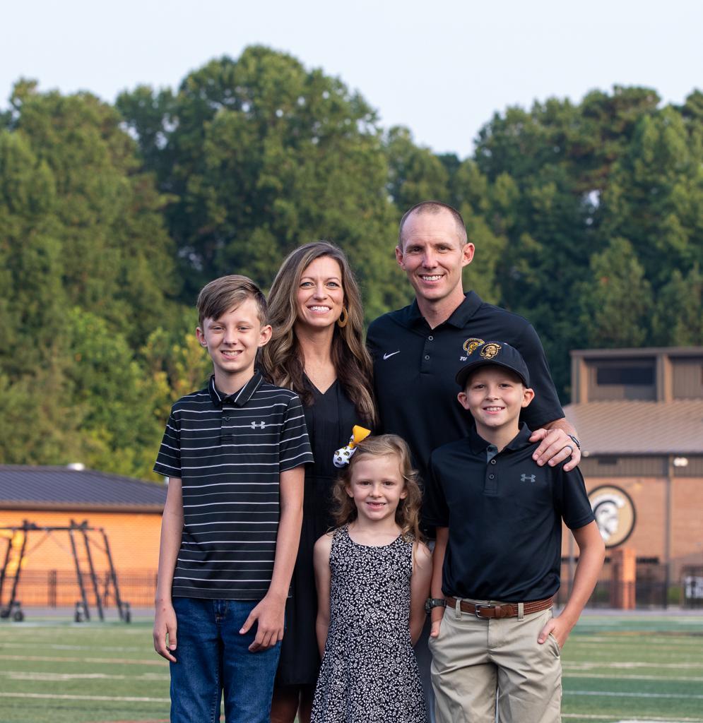 Photo of varsity head coach Joey King and family