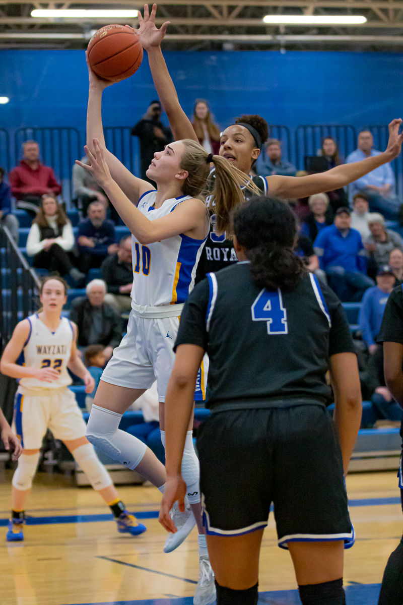 Wayzata's Mara Braun (10) drives for a layup under pressure from Hopkins' Maya Nnaji (34). Braun scored 22 points and Nnaji tallied 23 points. Hopkins defeated Wayzata 87-77 in in front of a packed home crowd Tuesday. Photo by Gary Mukai, SportsEngine