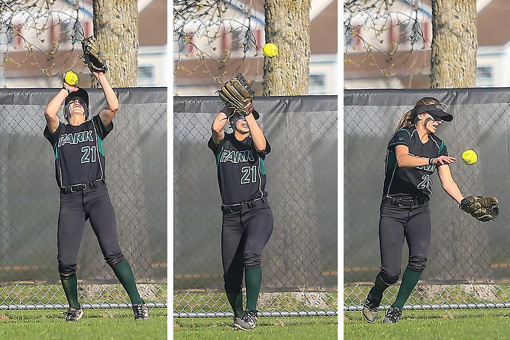 Park of Cottage Grove left fielder Corinna Loshek lost a sixth-inning drive in the sun, kept the ball alive with her throwing hand and made a juggling catch to end a Forest Lake threat. Photos by Mark Hvidsten, SportsEngine