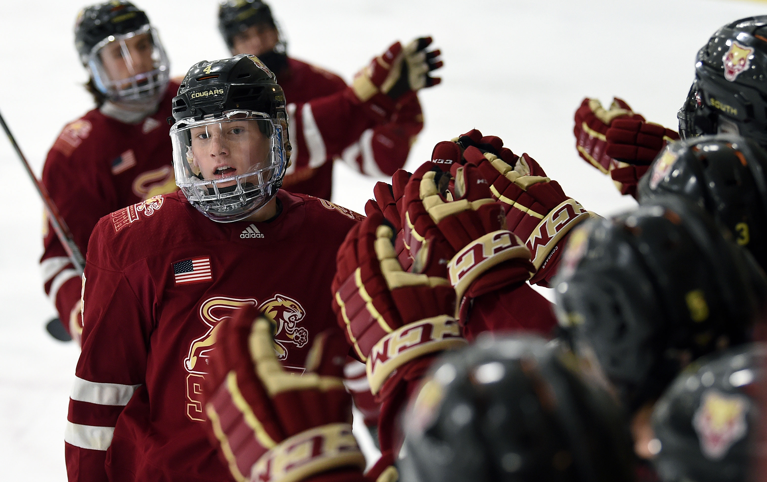 Lakeville South sophomore Tanner Ludtke celebrated one of his two goals Tuesday night in the Cougars' 4-3 victory over Maple Grove. Photo by Loren Nelson, SportsEngine