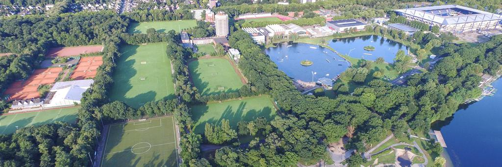 Bird's eye view of two small lakes, a stadium and lots of woods and nature in Duisburg Germany