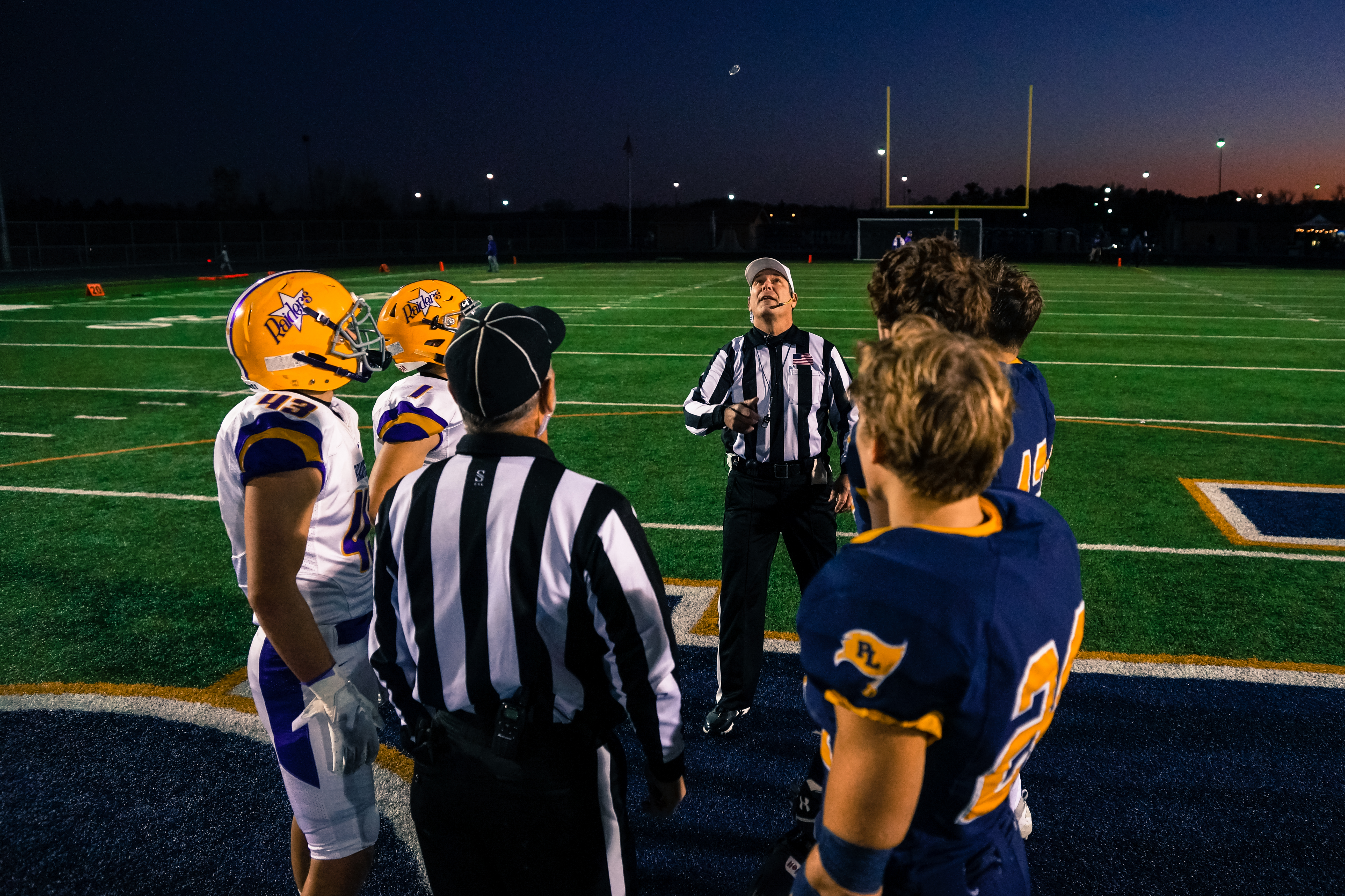 Cretin-Derham Hall and Prior Lake players watch the coin toss ahead of a Class 6A state tournament first round matchup on Oct. 15, 2019. The Raiders will begin their inaugural season in Class 5A on Sept. 2 against Spring Lake Park. Photo by Korey McDermot