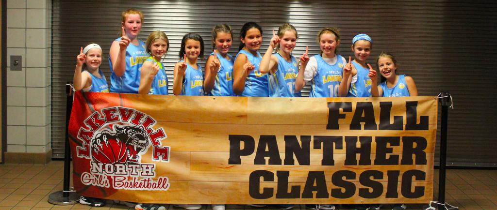 5th grade girls posing after beating Eastview in the Championship game of the 2018 Lakeville North Panther Classic Youth Basketball tournament They won the game by a score of 19-16