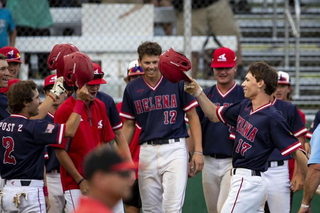 The Helena Senators' Hunter Lindgren (17) celebrates his home run with his teammates during their game against the Kalispell Lakers in the second round of the Class AA American Legion baseball state tournament at Pirtz Field on Thursday.  MIKE CLARK, Bill