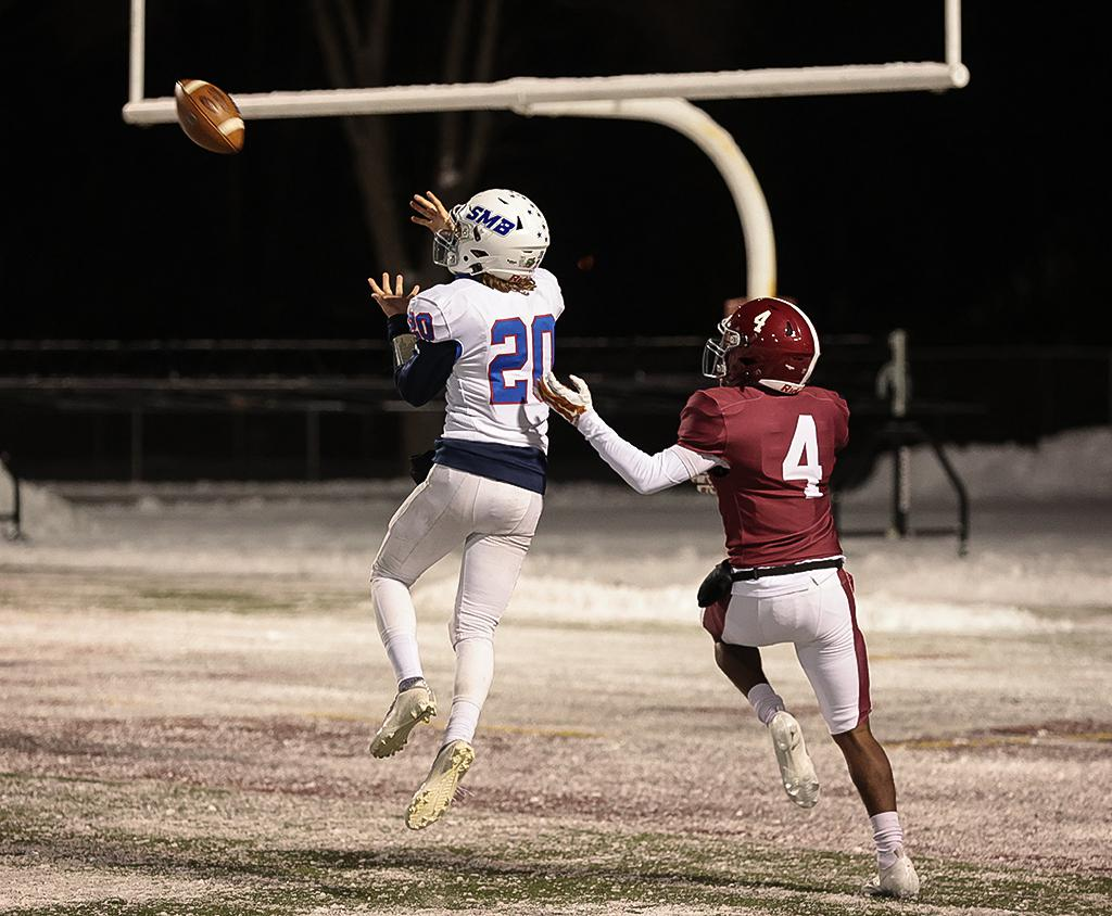 Judah Thomas (20) pulls down an interception at the goal line in the final minutes of the game. Thomas led the Wolfpack's offense, completing three touchdown passes and a rushing TD to finish the game. Photo by Cheryl A. Myers, SportsEngine