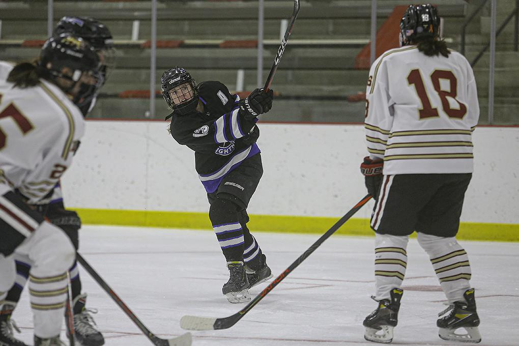 Eastview junior Avery Chesek (13) takes a shot on the Lakeville South goal in the first period. Her shot from a similar spot in overtime won the game for the Lightning. Photo by Mark Hvidsten, SportsEngine