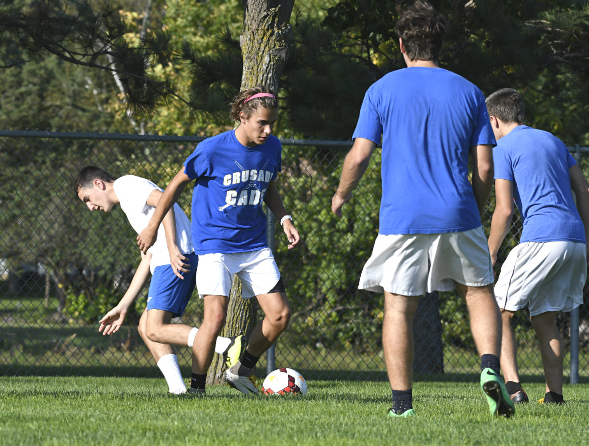 Forward Cole Tetrault moves the ball in practice against teammates. He's one of nine seniors playing for St. Cloud Cathedral this season. Photo by Cole Mayer, SportsEngine