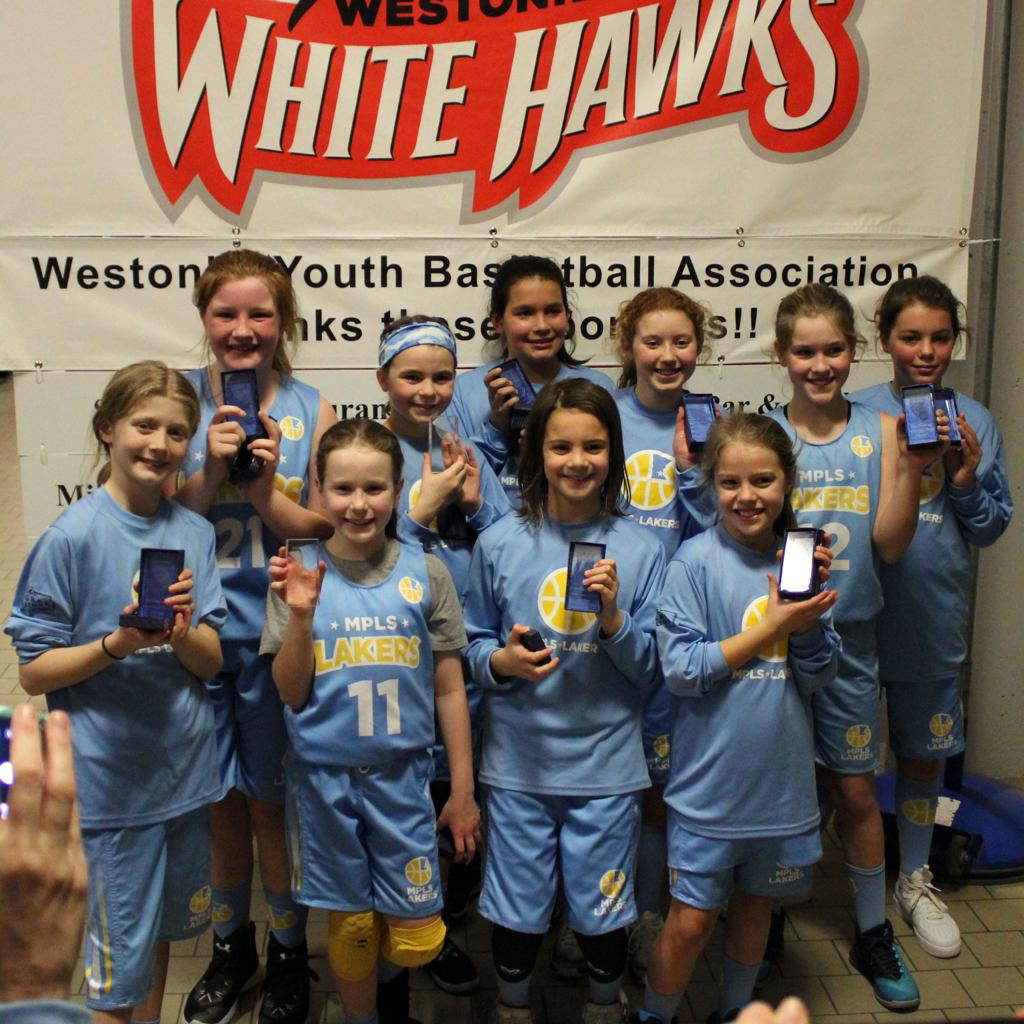 Minneapolis Lakers Girls 5th Grade Gold pose with their hardware after taking 2nd Place at Westonka White Hawk Classic