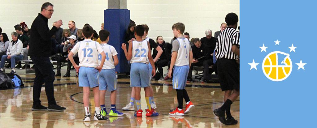 Minneapolis Lakers 6th Grade Gold during a timeout. They earned 3rd place at the Bloomington Lions Invitational tournament in Bloomington, MN