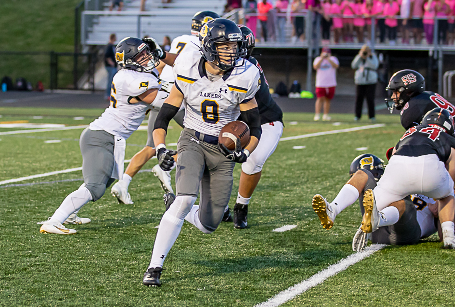 Prior Lake junior running back Tyler Shaver, who had 104 yards on 21 carries, goes up the field against Shakopee at Vaughan Field in Shakopee. The Lakers beat the Sabers 14-12 on Friday Night. Photo by Gary Mukai, SportsEngine